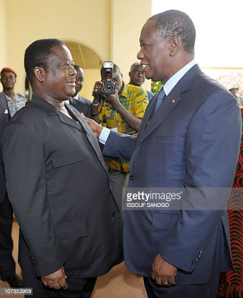 Former Ivory Coast president Henri Konan Bedie welcomes former Prime Minister and leader of the Ivory coast opposition party Alassane Ouattara on...