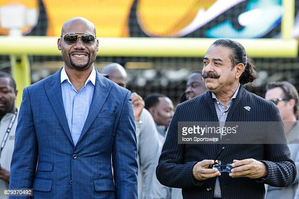 Former Jacksonville Jaguars wide receiver Jimmy Smith and Jacksonville Jaguars owner Shad Khan during the NFL game between the Minnesota Vikings and...