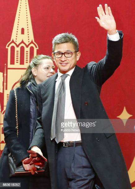 Former Japan and Yokohama FC striker Kazuyoshi Miura arrives at the State Kremlin Palace in Moscow on Dec 1 for the draw of the 2018 soccer World Cup...