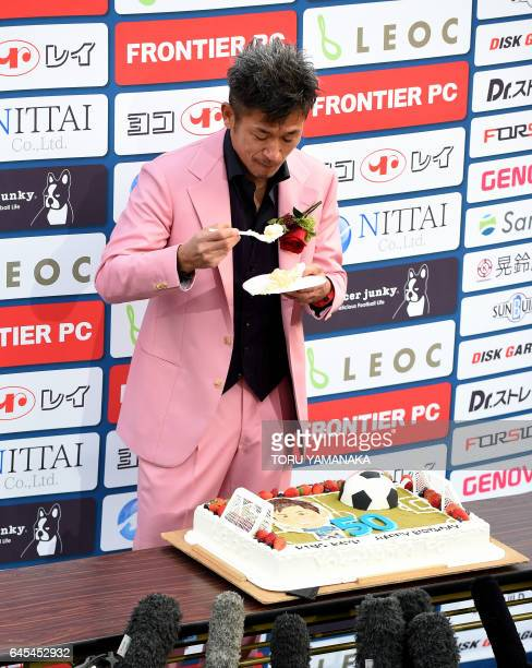 Former Japan striker Kazuyoshi Miura of the JLeague secondtier club Yokohama FC eats birthday cake during a press conference after the opening match...