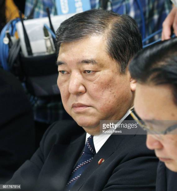 Former Japanese Defense Minister Shigeru Ishiba attends a meeting of the Liberal Democratic Party's constitutional reform panel in Tokyo on March 14...