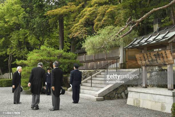 Former Japanese Emperor Akihito is pictured before visiting the mausoleum of Emperor Komei -- who was on the throne from 1846 to 1866 -- in Kyoto on...
