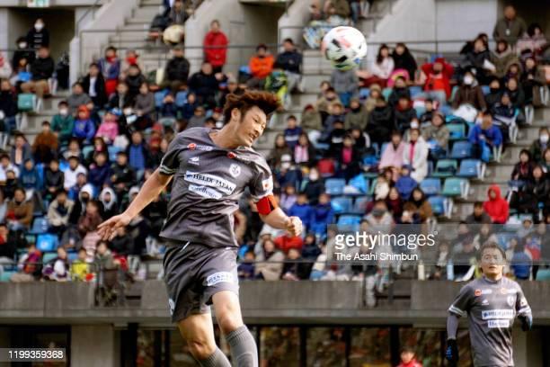 Former Japanese international Seiichiro Maki heads during the testimonial at Egao Kenko Stadium on January 13, 2020 in Kumamoto, Japan.