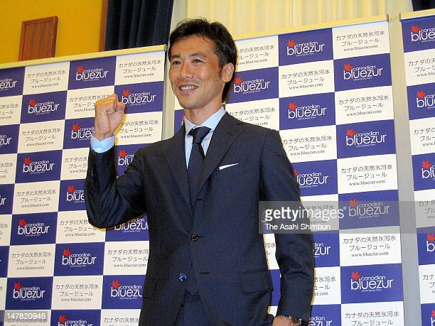 Former Japanese international Toshiya Fujita poses for photographs during a press conference to announce his retirement on July 3 2012 in Tokyo Japan