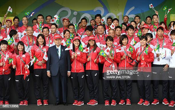 Former Japanese Prime Minister and head of the committee for the 2020 Games hosted by Tokyo Yoshiro Mori stands with members of Japan's Olympic team...