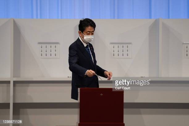 Former Japanese Prime Minister Shinzo Abe casts his vote in the Liberal Democrat Party leadership election on September 29, 2021 in Tokyo, Japan....