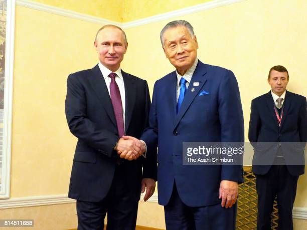 Former Japanese Prime Minister Yoshiro Mori and Russian President Vladimir Putin shake hands prior to their meeting on July 3 2017 in Moscow Russia