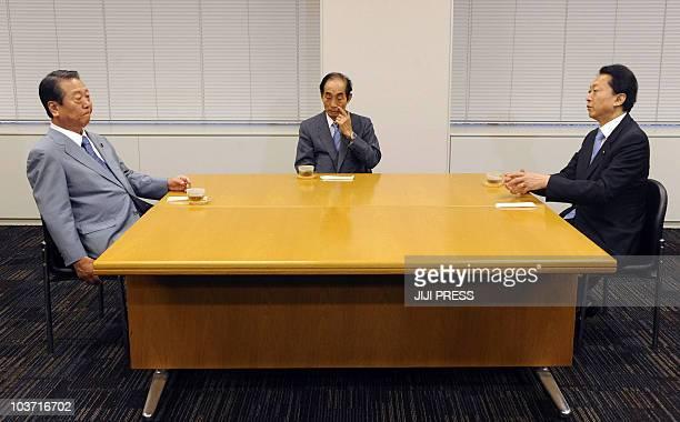 Former Japanese prime minister Yukio Hatoyama talks to Ichiro Ozawa and House of Councilors speaker Azuma Koshiishi at the members' office building...