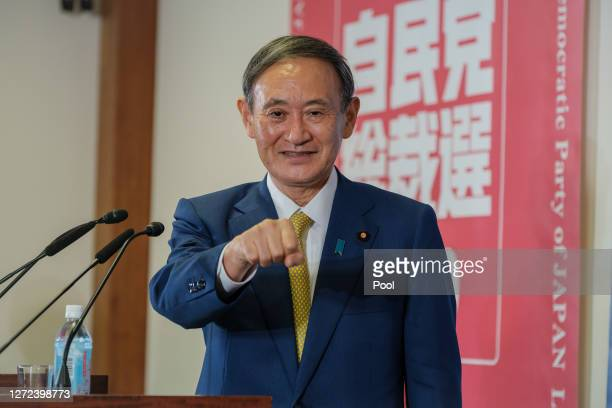 Former Japan's Chief Cabinet Secretary Suga Yoshihide gestures before a press conference at the Liberal Democratic Party Headquarter after being...