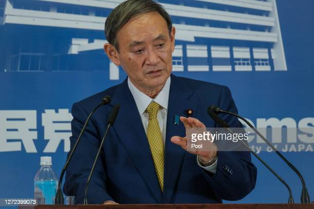 Former Japan's Chief Cabinet Secretary Suga Yoshihide gestures during a press conference at the Liberal Democratic Party Headquarter after being...