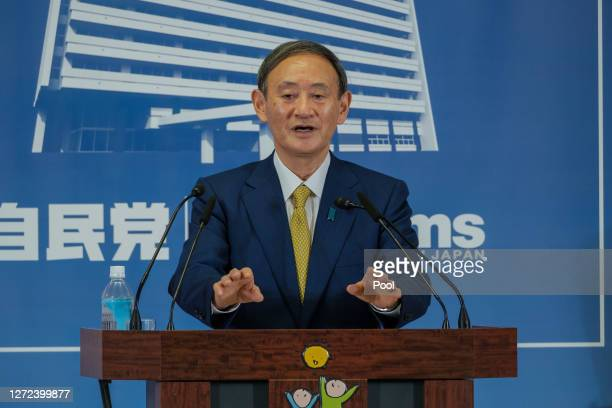 Former Japan's Chief Cabinet Secretary Suga Yoshihide makes a gesture during a press conference at the Liberal Democratic Party Headquarter after...