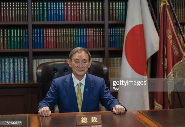 Former Japan's Chief Cabinet Secretary Suga Yoshihide poses for a portrait picture on the Party President seat following the press conference after...