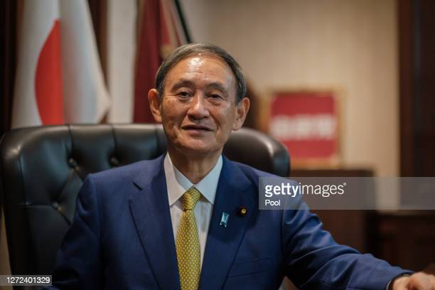 Former Japan's Chief Cabinet Secretary Suga Yoshihide poses for a portrait picture following the press conference after being elected as Liberal...