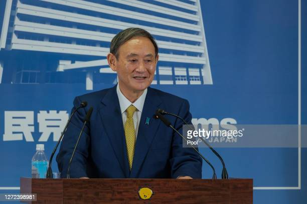 Former Japan's Chief Cabinet Secretary Suga Yoshihide smiles during a press conference at the Liberal Democratic Party Headquarter after being...