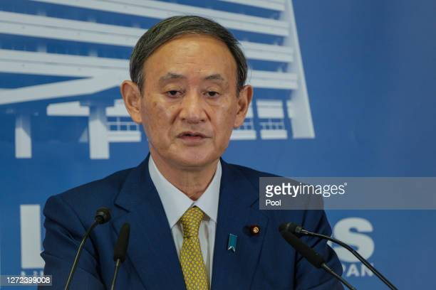 Former Japan's Chief Cabinet Secretary Suga Yoshihide speaks during a press conference at the Liberal Democratic Party Headquarter after being...