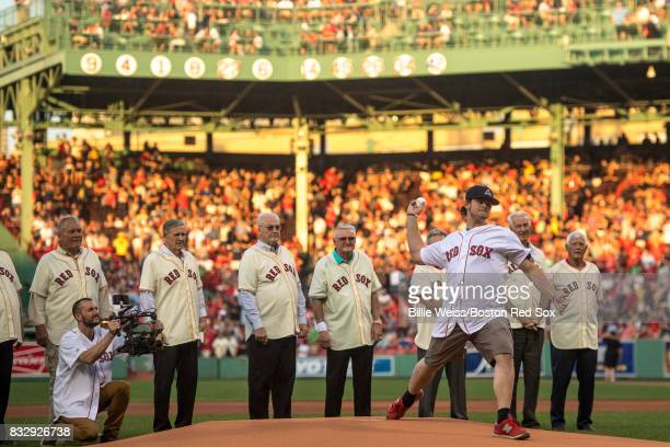 Former Jimmy Fund patient Jordan Leandre throws out the ceremonial first pitch alongside members of the 1967 Boston Red Sox are introduced during a...