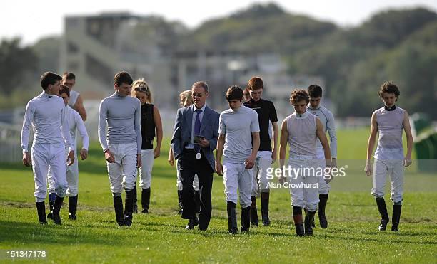 Former jockey John Reid walks the course with the apprentices at Salisbury racecourse on September 06 2012 in Salisbury England