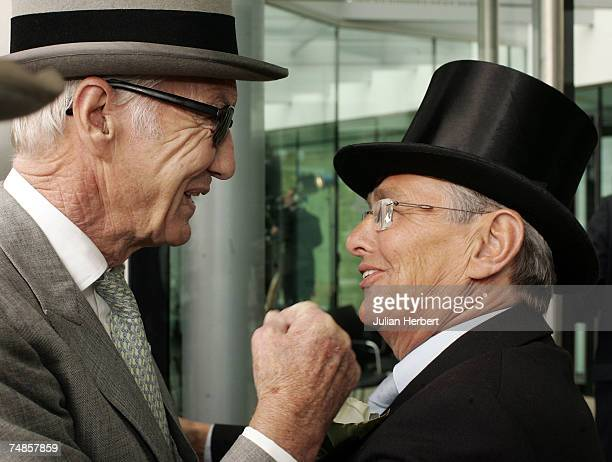 Former jockey Lester Piggott is greeted by former jockey and tv pundit Willie Carson as he arrives at Ascot Racecourse on the fourth day of The Royal...