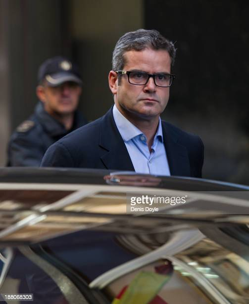 Former JP Morgan Chase trader Javier MartinArtajo leaves Spain's National Court on extradition charges to the United States on November 15 2013 in...
