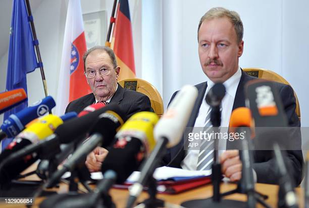 Former judge at the German federal Supreme Court Gerhard Schaefer and Interior Minister of Thuringian region Joerg Geibert give a press conference on...