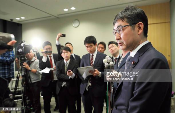 Former Justice Minister Katsuyuki Kawai speaks to media after offices of his wife and Upper House lawmaker Anri Kawai and his office in Hiroshima...