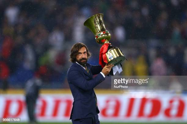 Former Juventus and Milan player Andrea Pirlo with the cup during the TIM Cup Final between Juventus and AC Milan at Stadio Olimpico on May 9 2018 in...