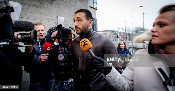 Former K1 heavyweight kickboxing champion Badr Hari talks to the press as he arrives at the Amsterdam courtroom on 22 January 2014 Hari faces several...