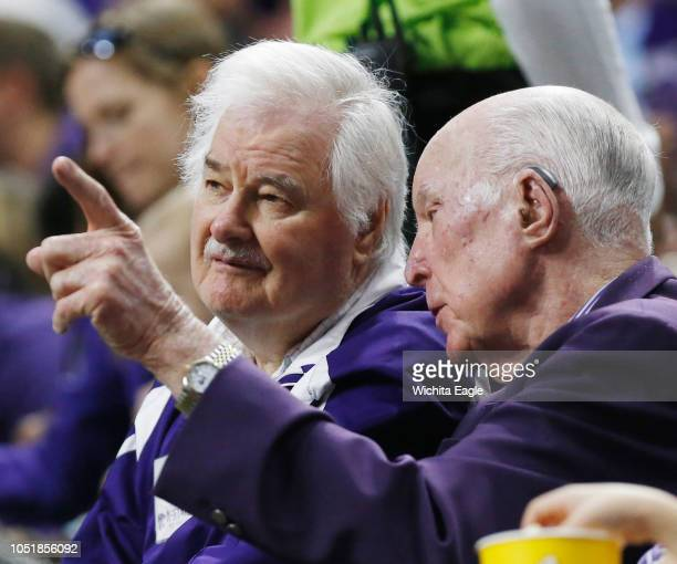 Former Kanas State coach Tex Winter left and Ernie Barrett share a moment during a visit from Oklahoma State at Bramlage Coliseum in Manhattan Kan on...