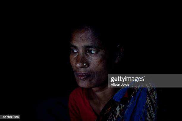 Former Kandapara brothel sex worker 37 year old Parvin Shanti Akhter sits for a photograph on October 17 2014 in Tangail Bangladesh Parvin was...