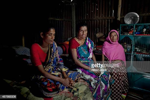 Former Kandapara brothel sex workers 37 year old Parvin Shanti Akhter 50 year old Razia Khatoon and 26 year old Nilupa Yasmin sit for a photo October...