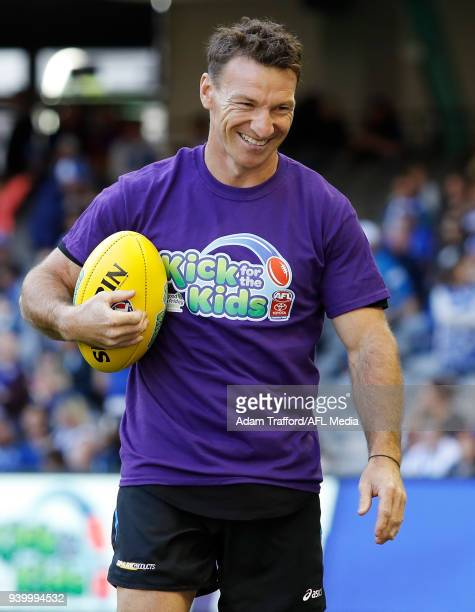 Former Kangaroos legend Brent Harvey looks on as part of the kick for kids activation to raise money for the Royal Children's Hospital during the...