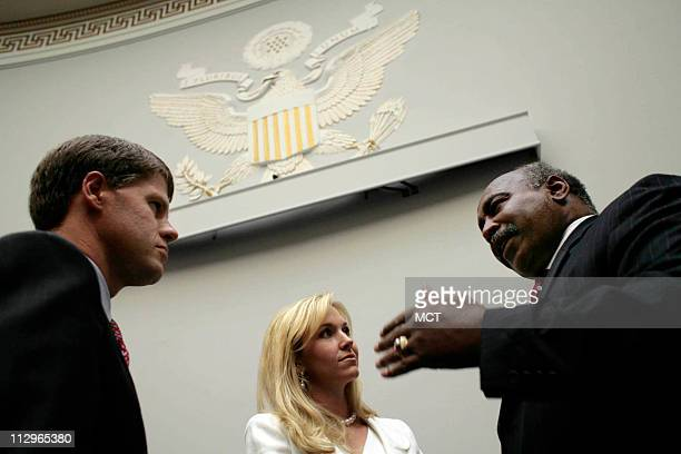 Former Kansas City Chiefs linebacker Willie Lanier chats with Tavia Hunt and Clark Hunt Owner and Chairman of the Kansas City Chiefs at a reception...