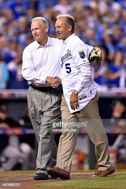 Former Kansas City Royals catcher John Wathan shakes hands with former Royals third baseman George Brett after the pair conspired to throw out the...