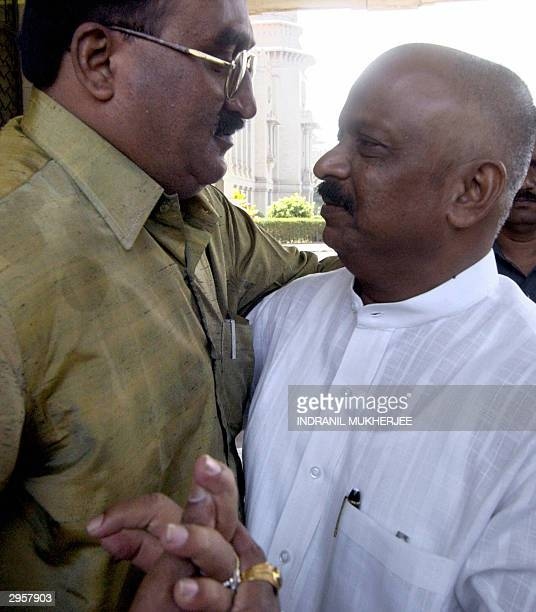 Former Karnataka state minister Roshan Baig greets a wellwisher after he walked out of the Vidhan Soudhastate legislature in Bangalore 10 February...