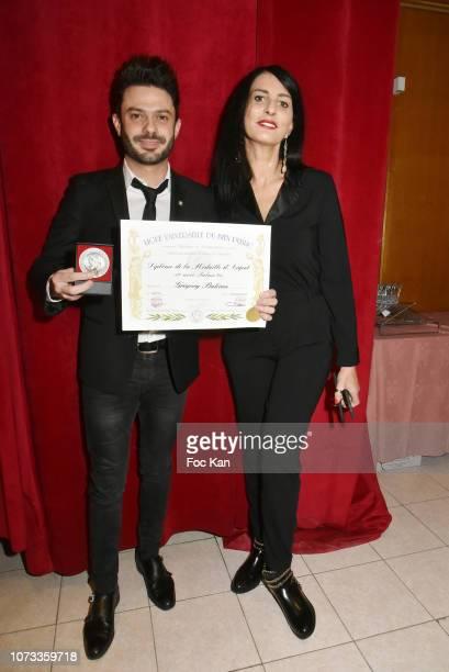Former Karting champion/singer Gregory Bakian and Sylvie Ortega Munos attend Gregory Bakian Ligue Universelle Du Bien Public Medal Remittance...