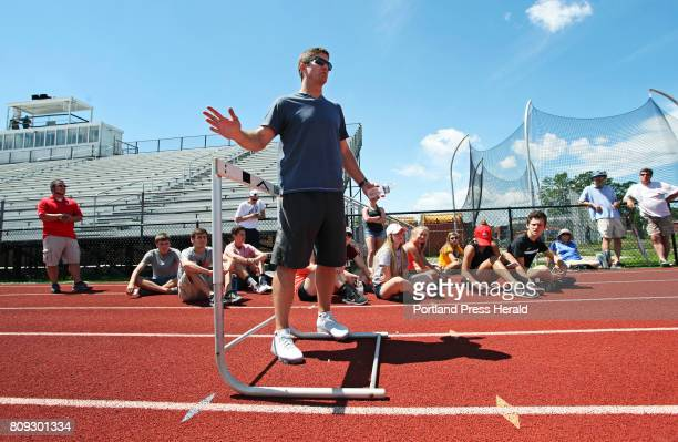 Former Kennebunk High School track star Jamie Cook talks about hurdle drills while holding an instructional practice and Q A with Olympic athletes...