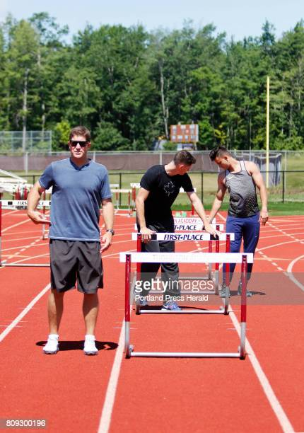 Former Kennebunk High School track star Jamie Cook talks about proper form while Olympic athletes Johnathan Cabral and Devon Allen set up hurdles at...