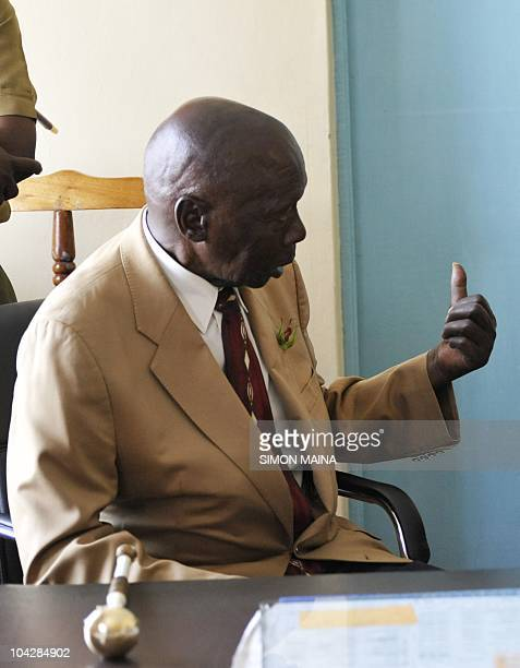 Former Kenyan P resident Daniel arap Moi speaks on September 17 2010 to Kenya's world 800m record holder David Rudisha after the latter came back to...