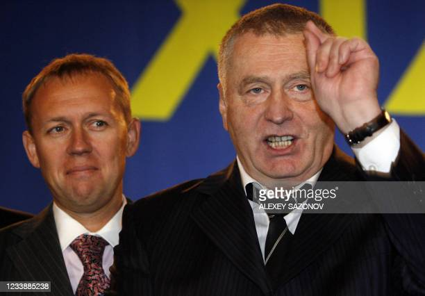 Former KGB officer Andrei Lugovoi , who is wanted in Britain for the murder of former Russian agent Alexander Litvinenko, listens to the leader of...