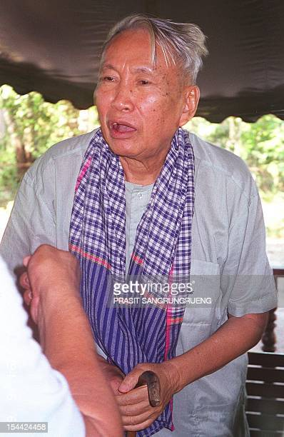Former Khmer Rouge leader Pol Pot talks to a journalist reportedly on 04 January 1998 in the guerrilla's jungle hideout in Northern Cambodia Pol Pot...