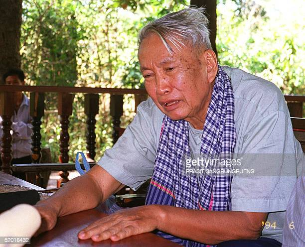Former Khmer Rouge leader Pol Pot talks to a journalist reportedly on 04 January in the guerrilla's jungle hideout in Northern Cambodia Pol Pot is...