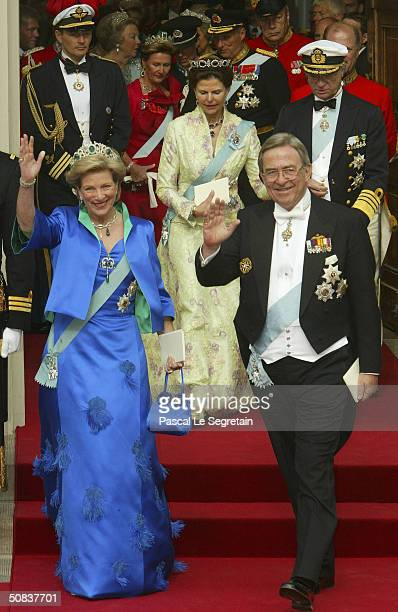 Former King Constantin of Greece and Queen Anne-Marie, aunt to Crown Prince Frederik, leave Copenhagen Cathedral after the wedding ceremony between...
