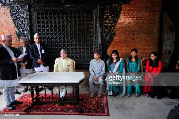 Former King Gyanendra Shah along with his grandson and grand daughters arrives from his residence to receives a greeting from his supporters and...
