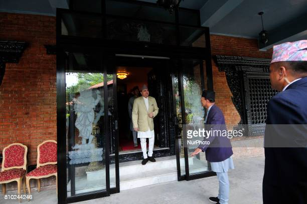 Former King Gyanendra Shah arrives from his residence to receives a greeting from his supporters and well-wishers on his 71th birthday at his...