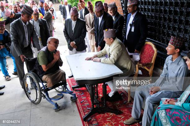 Former King Gyanendra Shah receives a greeting from his supporters and well-wishers on his 71th birthday at his residence Nirmal Niwas, Maharjagunj,...