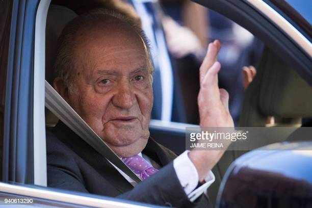 Former King Juan Carlos I of Spain waves as he leaves after attending the traditional Easter Sunday Mass of Resurrection in Palma de Mallorca on...