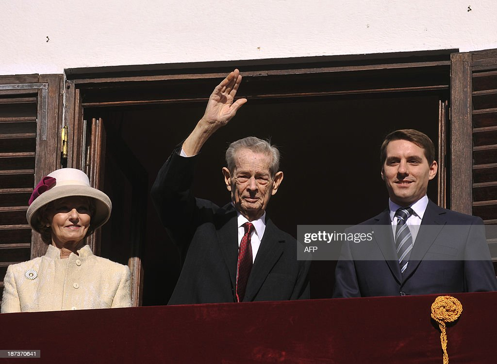 Former King of Romania Michael I (C) salutes the audience next to Princess Margareta (L) and Prince Nicolae (R) on the balcony of the Elisabeta Palace in Bucharest on November 8, 2013. Michael of Romania (92) who was ousted as king in 1948 made one of his rarely public appeareance on the occasion of the Feast of the Archangels Michael and Gabriel, one of the most important Christian-Orthodox feasts.