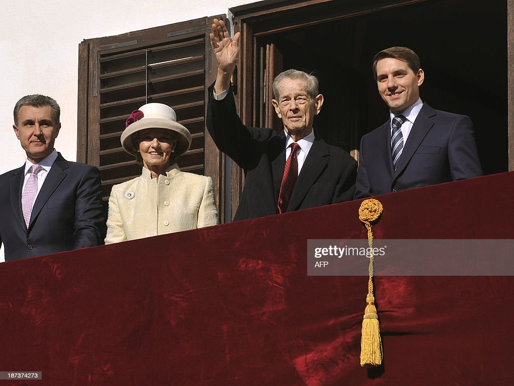 Former King of Romania Michael I (2dR) salutes the audience next to Prince Duda (L), Princess Margareta (2dL) and Prince Nicolae (R) on the balcony of the Elisabeta Palace in Bucharest on November 8, 2013. Michael of Romania (92) who was ousted as king in 1948 made one of his rarely public appeareance on the occasion of the Feast of the Archangels Michael and Gabriel, one of the most important Christian-Orthodox feasts.
