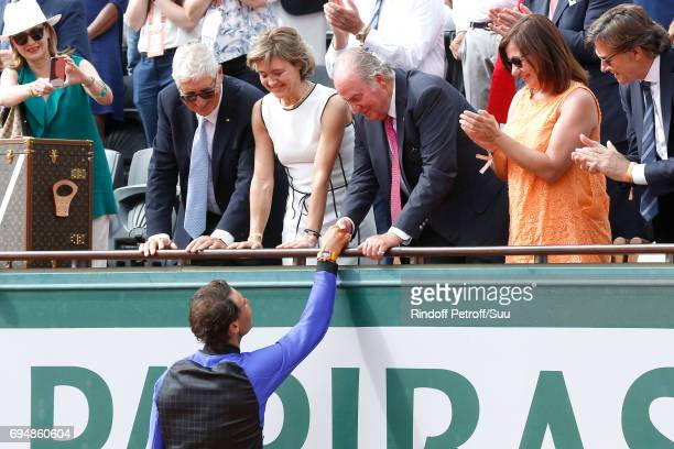 Former King of Spain Juan Carlos 1er congratulates Winner of 10 Roland Garros and of the 2017 edition Rafael Nadal after the Men Final of the 2017...