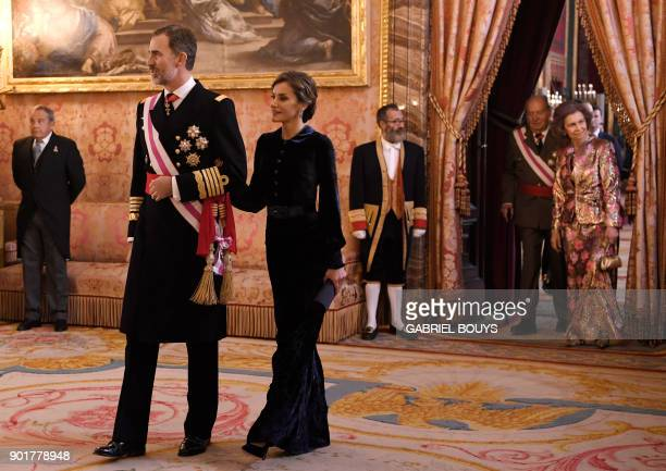Former King of Spain Juan Carlos I and his wife former queen Sofia follow his son Spain's King Felipe VI and Queen Letizia during the Epiphany Day...